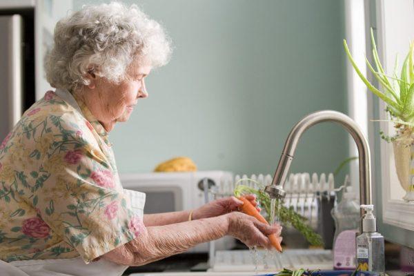 Baby Boomer at kitchen sink