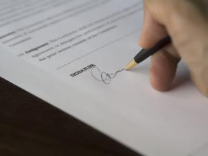 Signing a contract - pen and paper