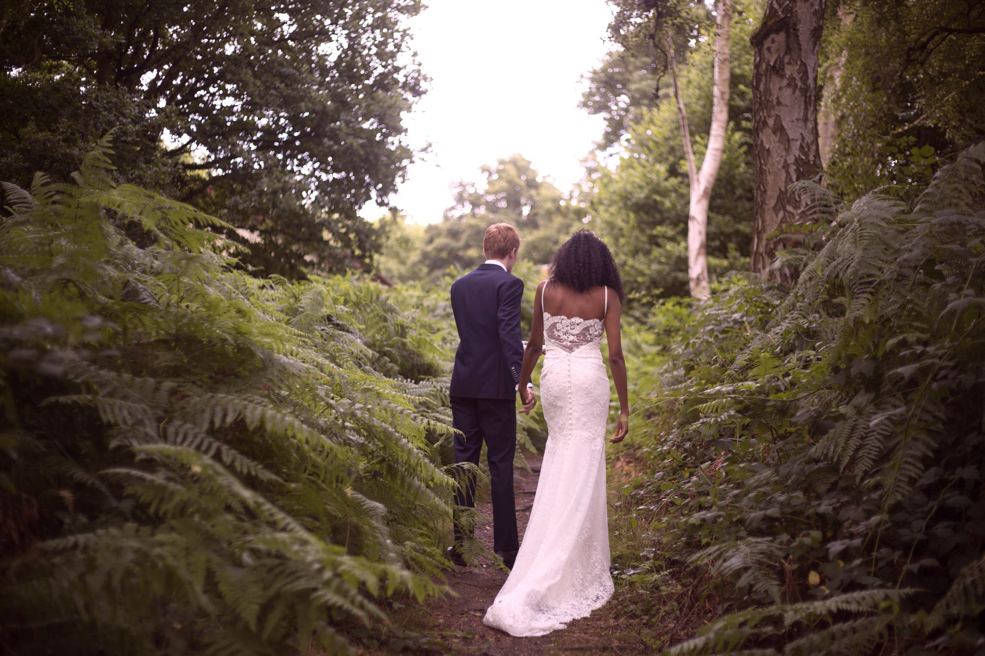 Bride and groom walk through the ferns Cuffley camp Essence of Australia wedding dress outdoor woodland wedding photographer