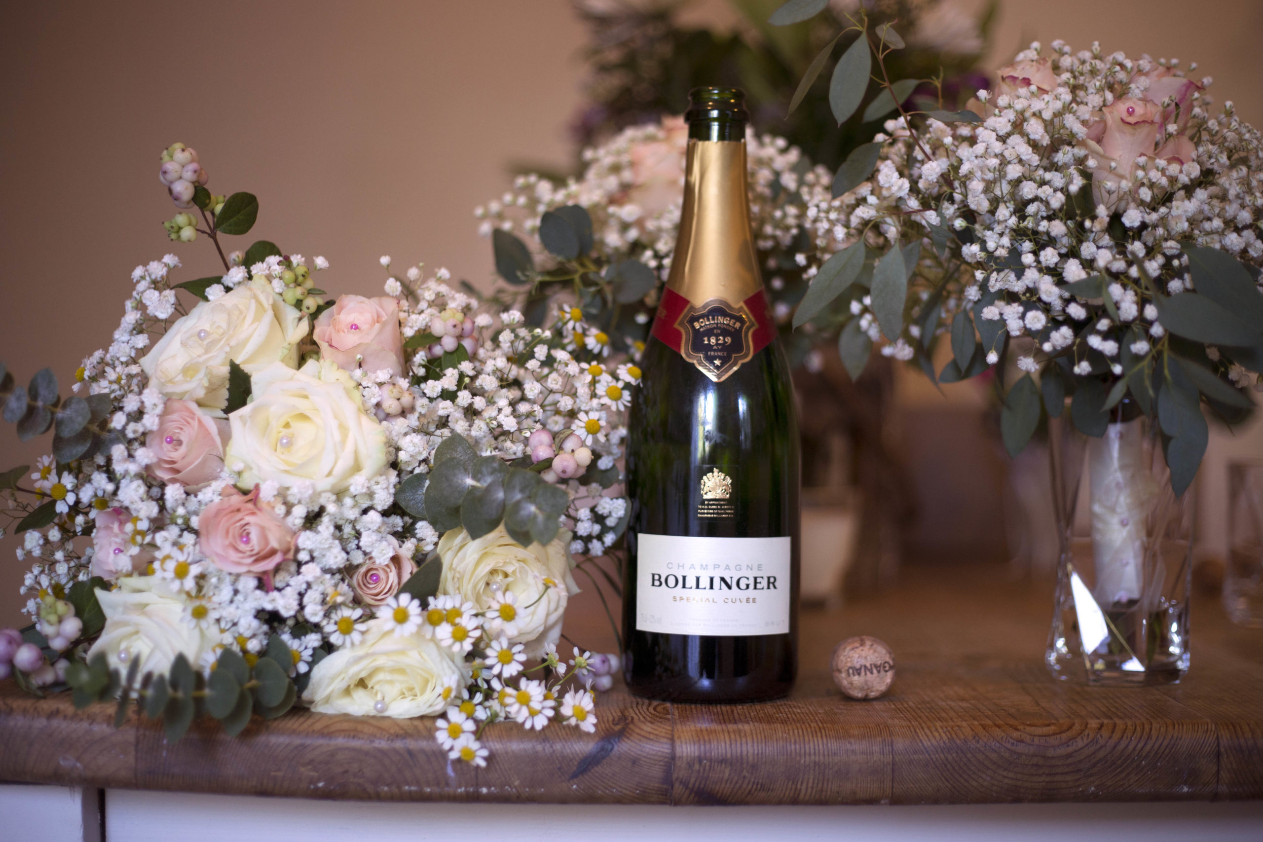 Champagne bottle and pastel pink wedding bouquet Rookery Manor Bristol Wedding Photographer
