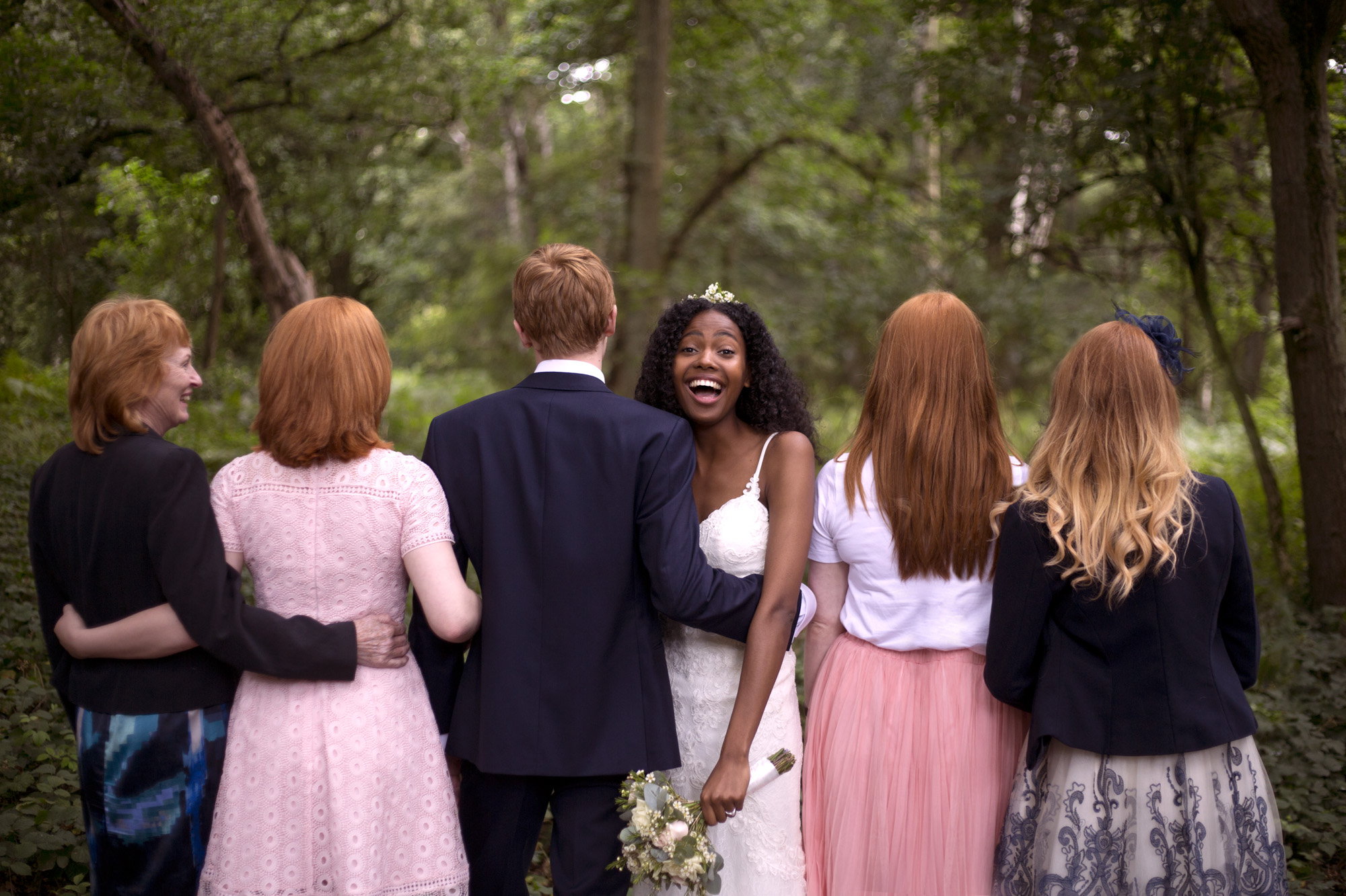 Ginger family portrait with laughing bride woodland wedding photographer