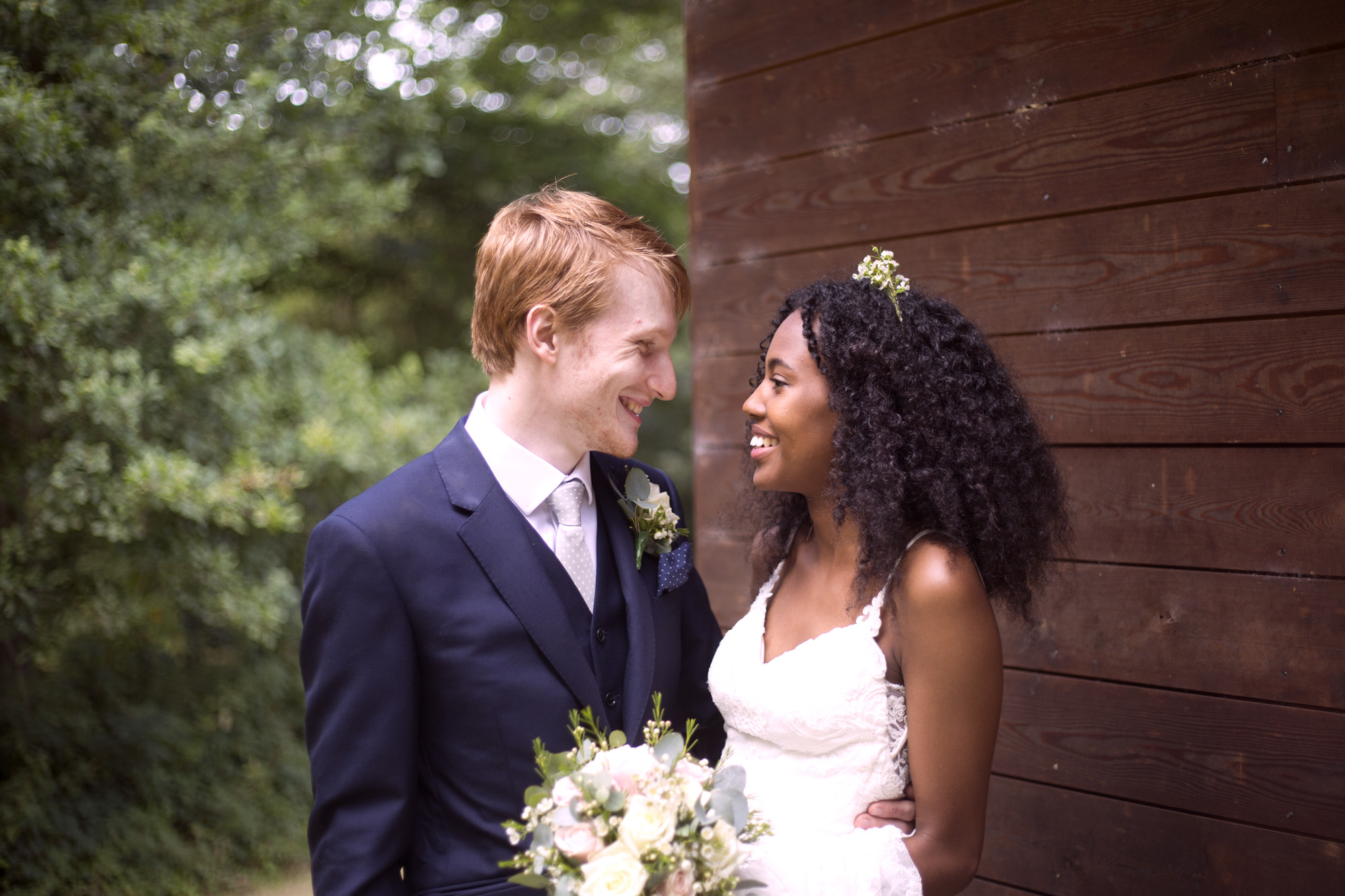 Bride and groom at Cuffley camp outdoor woodland wedding photographer