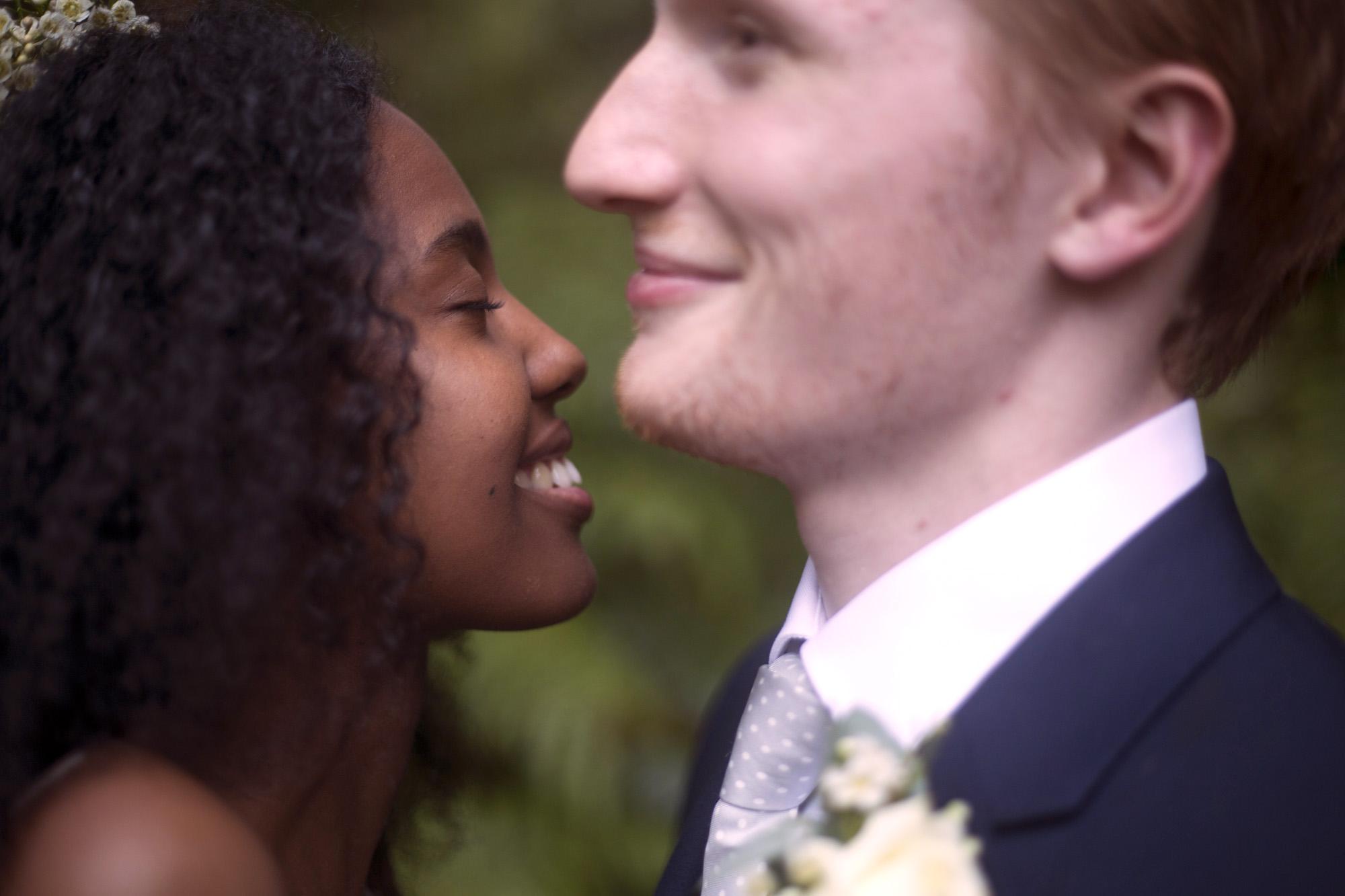Newlyweds smiling at Cuffley camp outdoor woodland wedding photographer