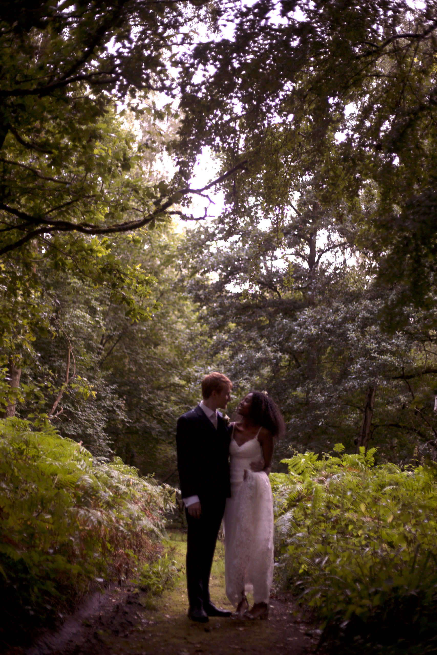 Silhouette of bride and groom at Cuffley camp outdoor woodland wedding photographer
