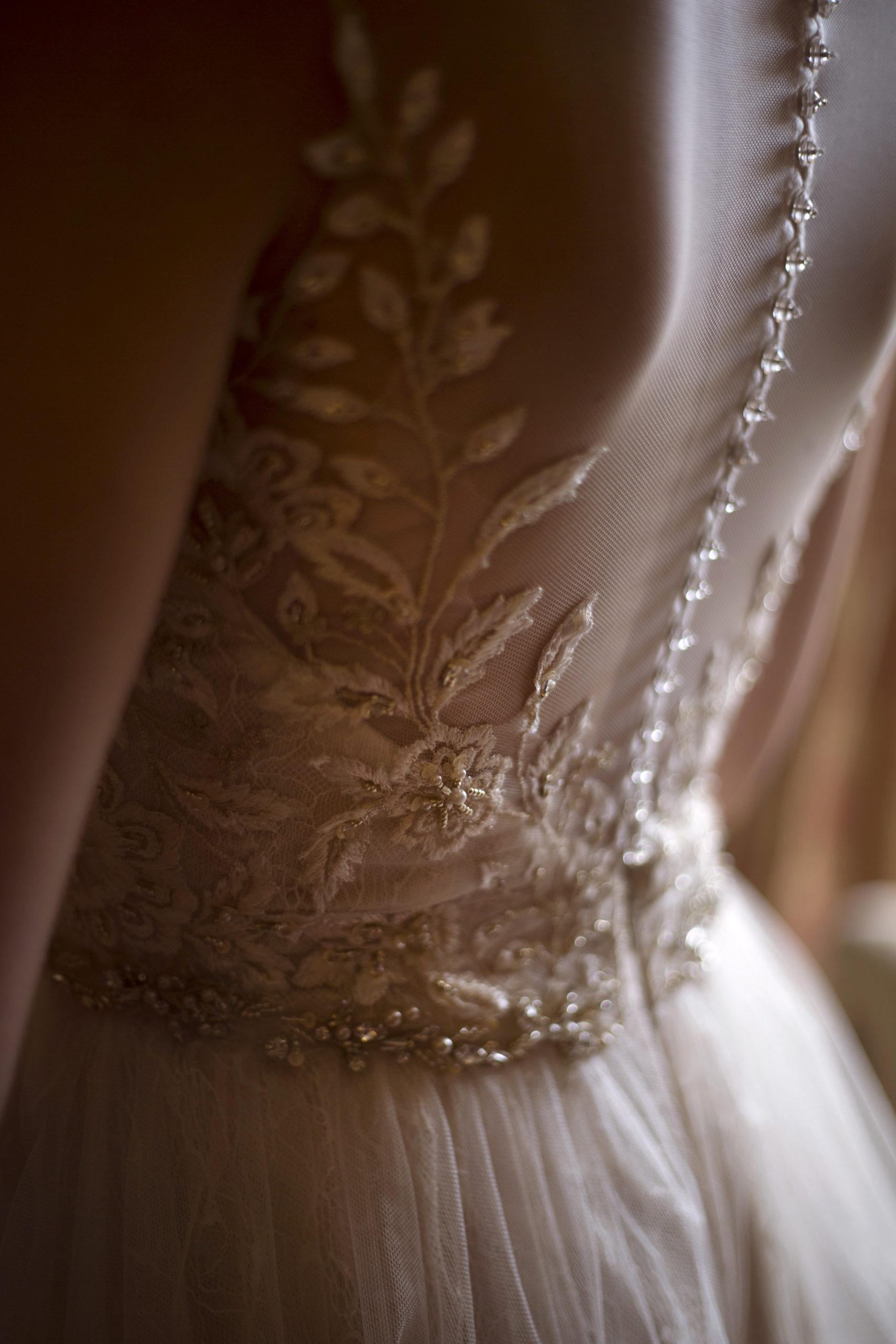Wedding dress lace leaf detail Cripps barn outdoor wedding photographer