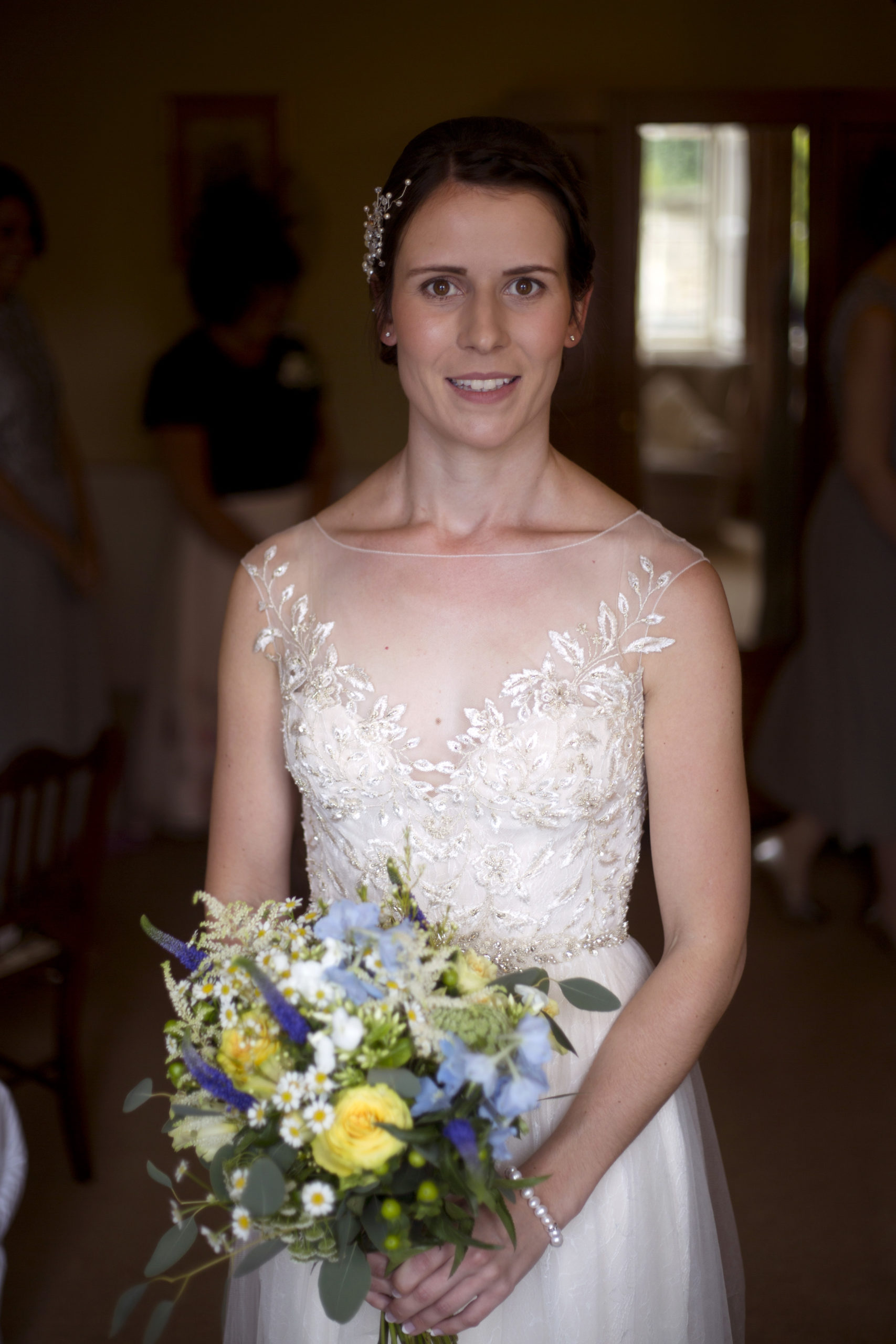Bride with yellow and blue bouquet portrait Cripps barn outdoor wedding photographer