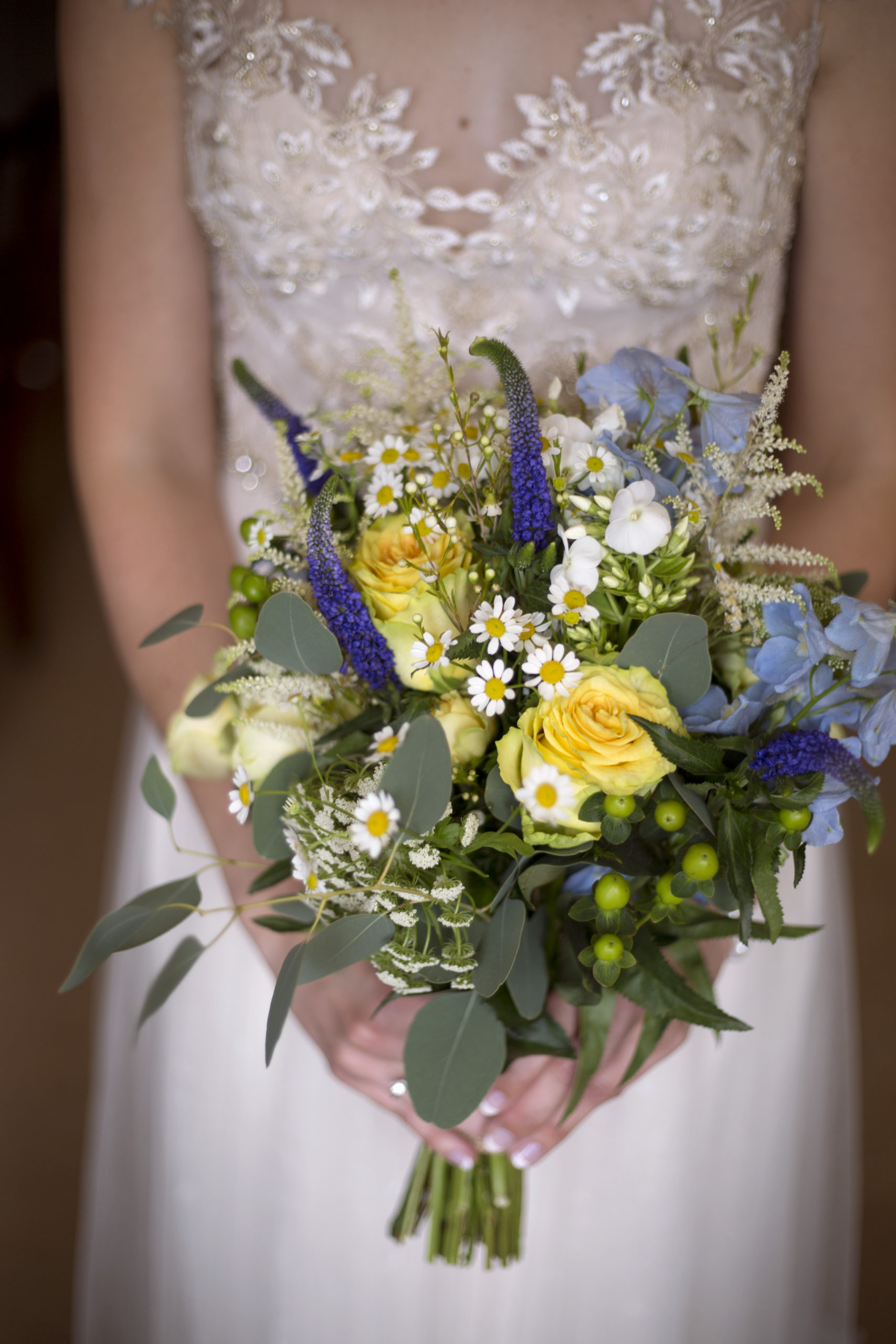 Bride with yellow blue rose wedding bouquet in Cripps barn wedding photographer gloucestershire
