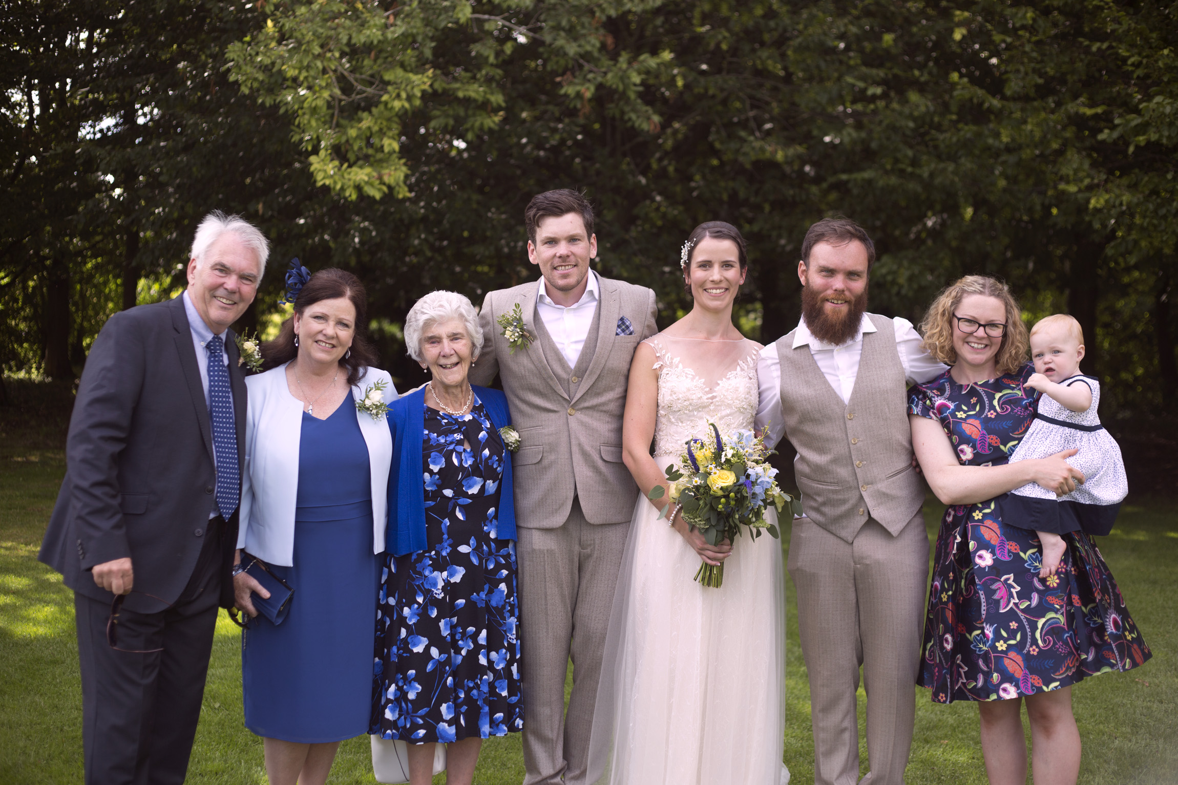 Family portrait with bride and groom Cripps barn outdoor wedding photographer