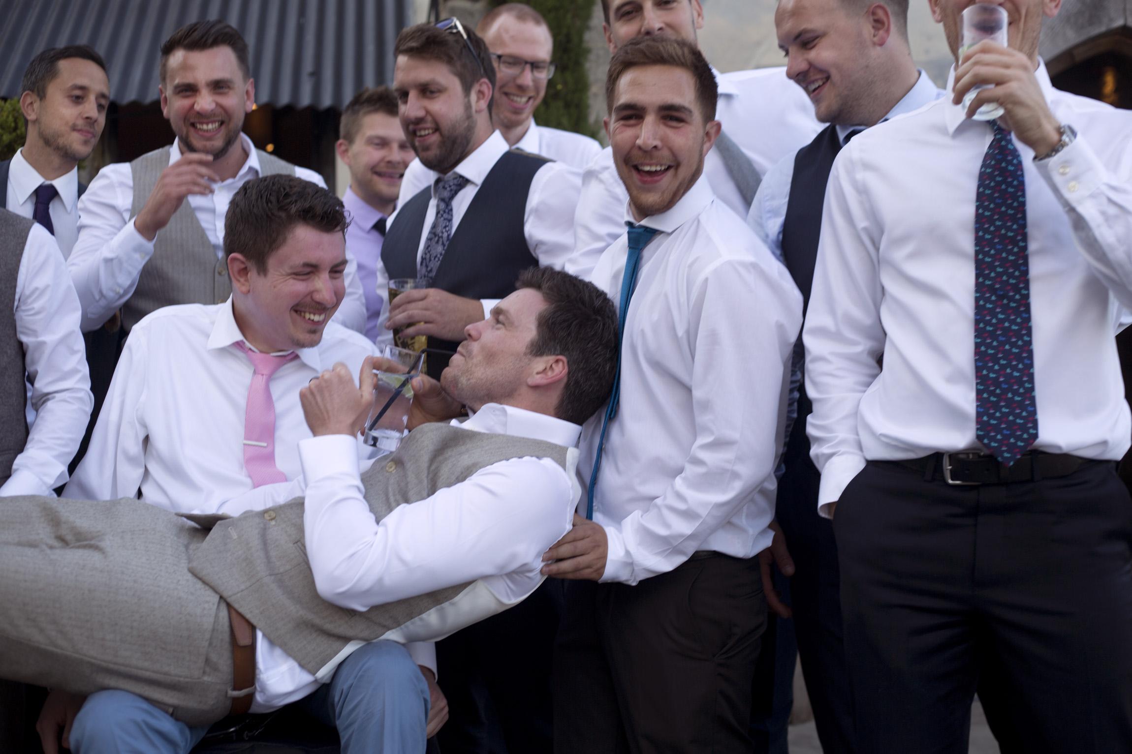 Groomsmen pick up groom Cripps barn outdoor wedding photographer