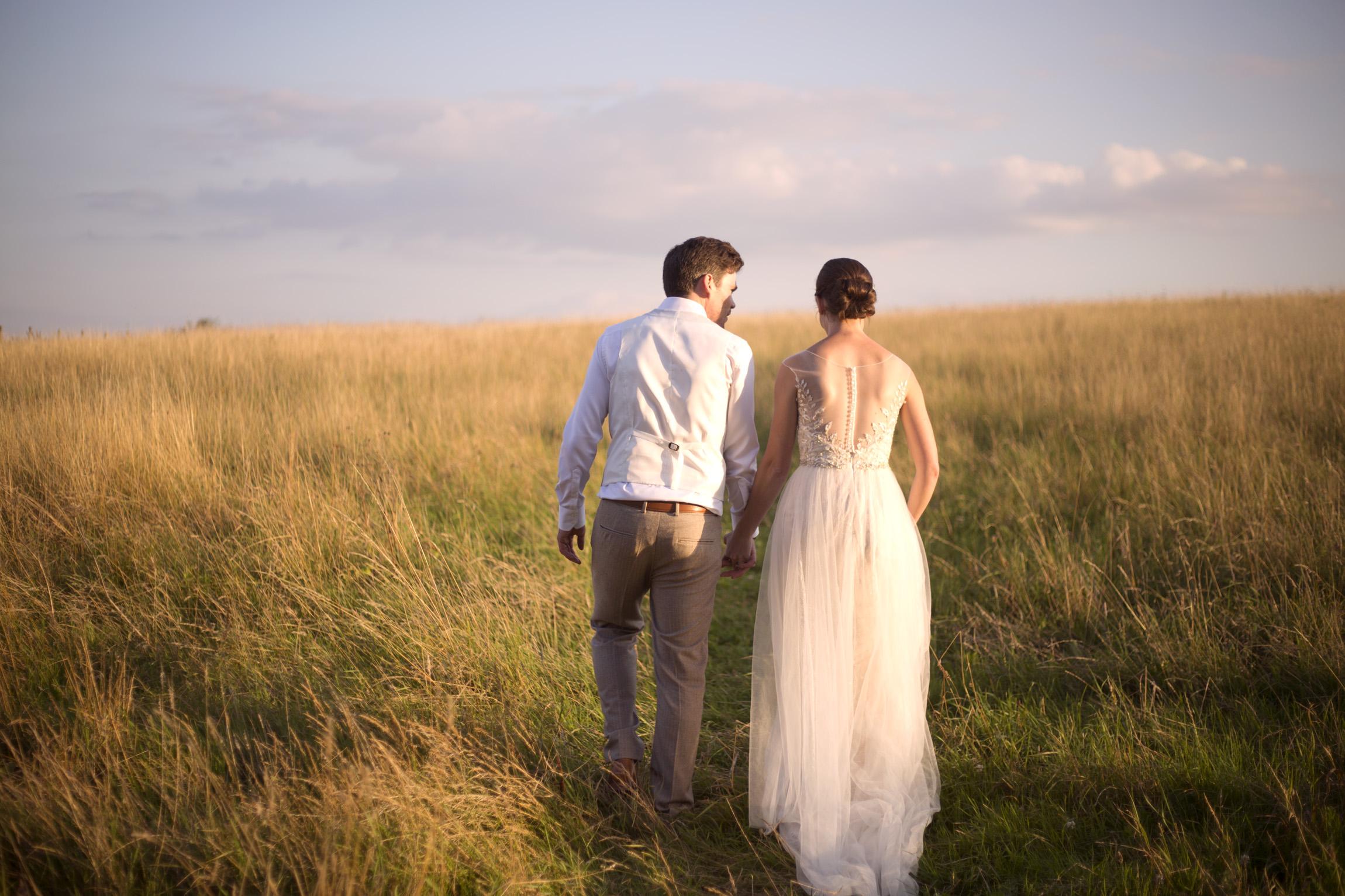 Bride and groom holding hands sunset golden hour Cripps barn outdoor wedding photographer