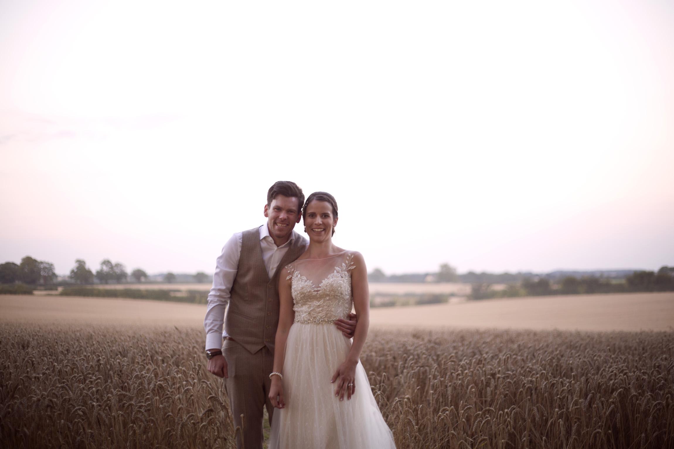 Smiling bride and groom portrait shoot in cornfield Cripps barn outdoor wedding photographer