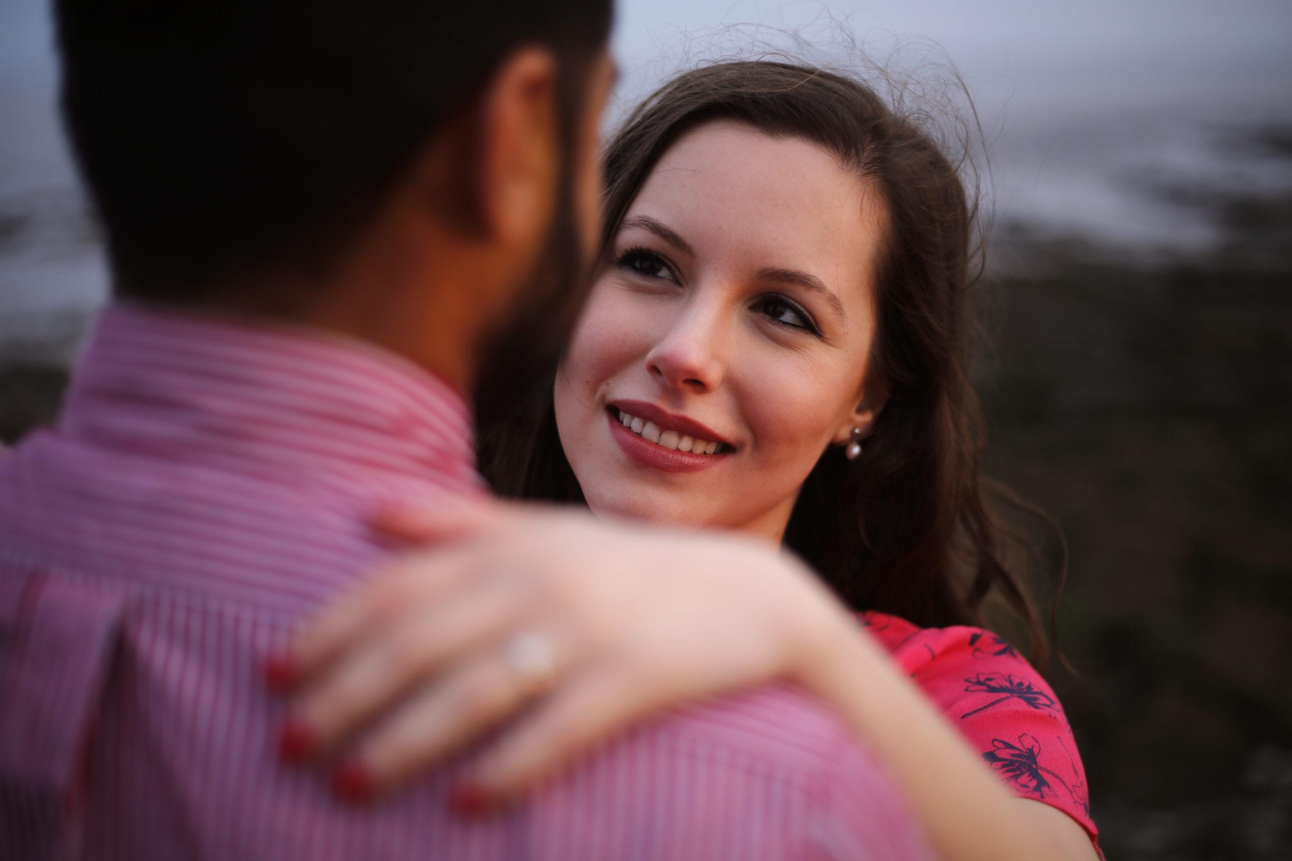 Engaged couple smiling on the Wentloog Levels Cardiff