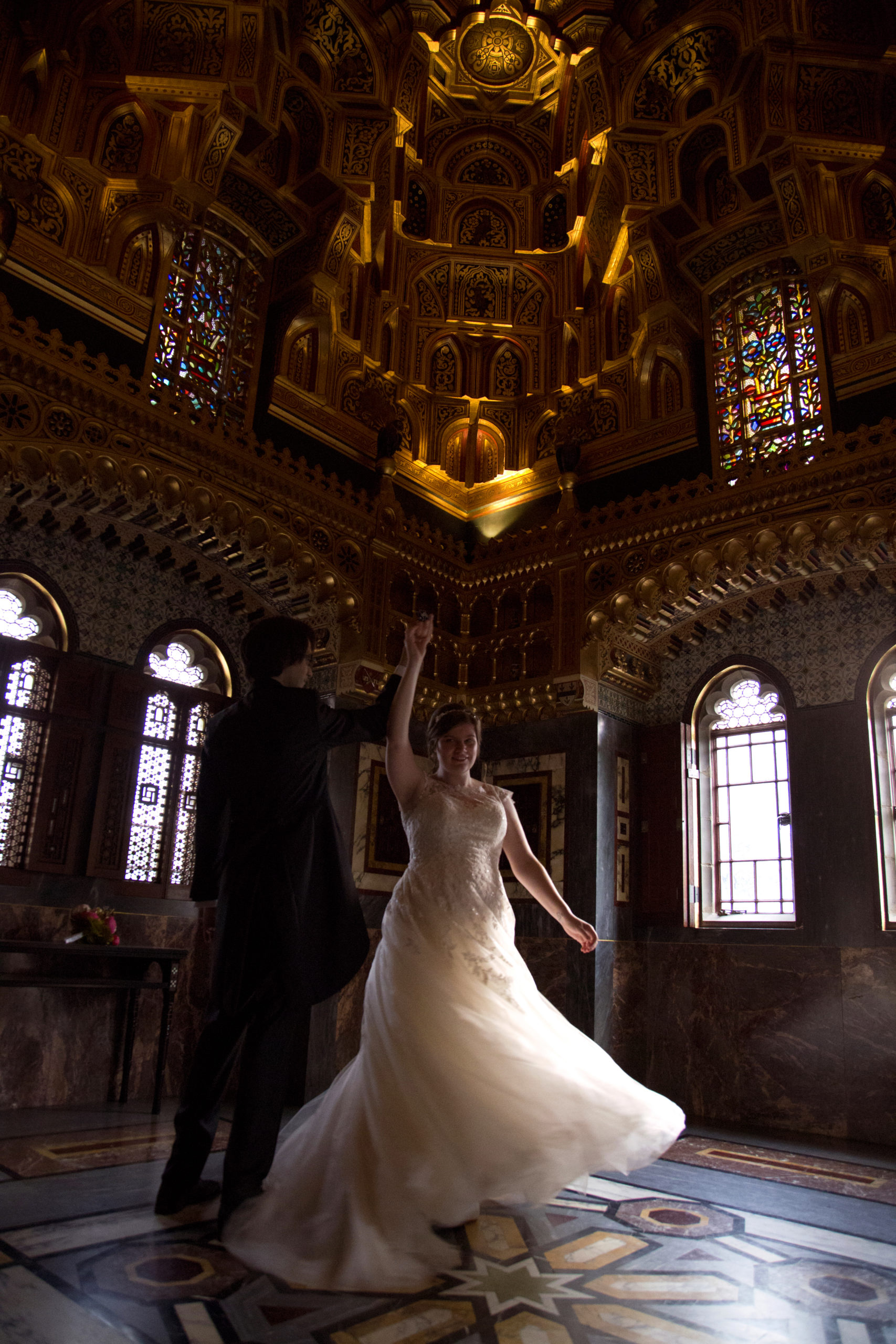Bride and groom spinning dancing in Arab room in Cardiff Castle Wedding Photographer St Teilos
