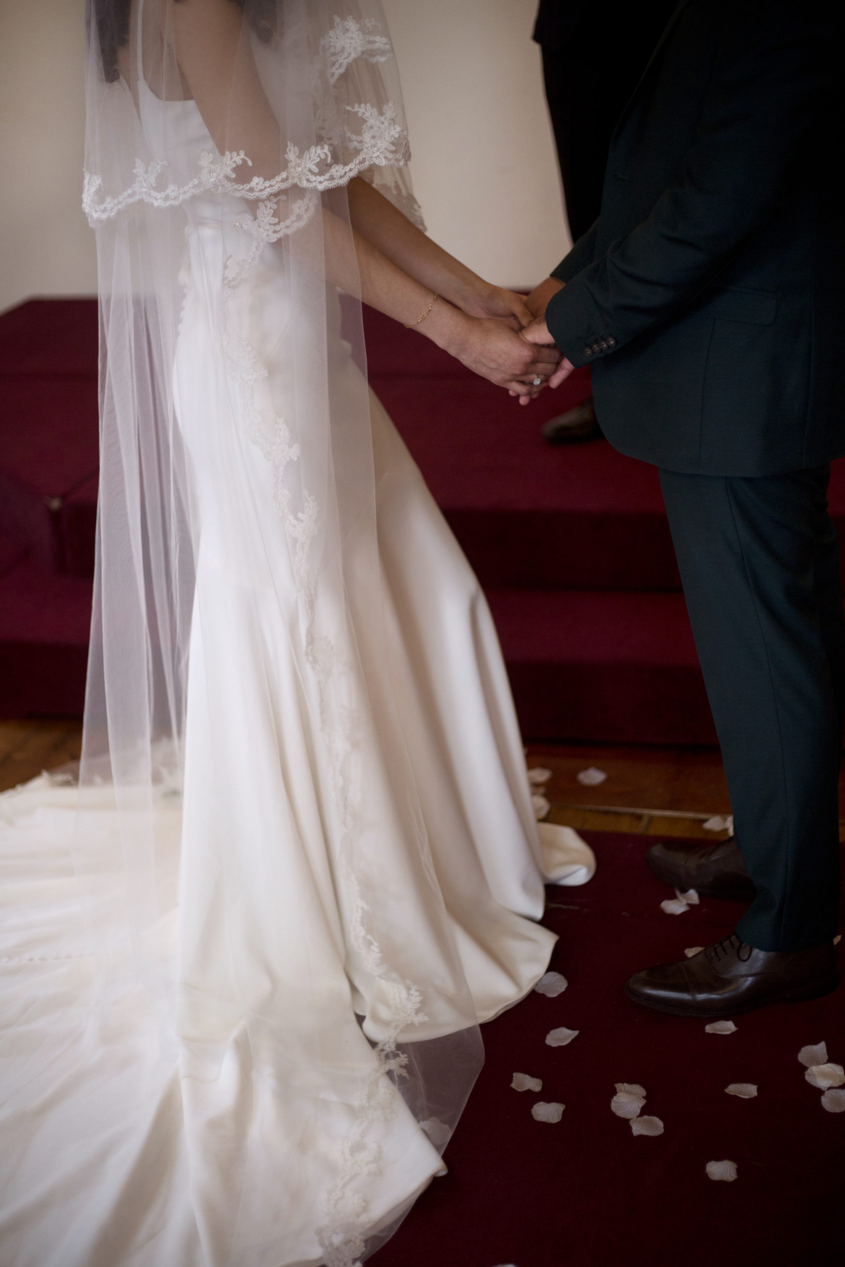 Bride and Groom hold hands in church micro wedding photographer Bristol