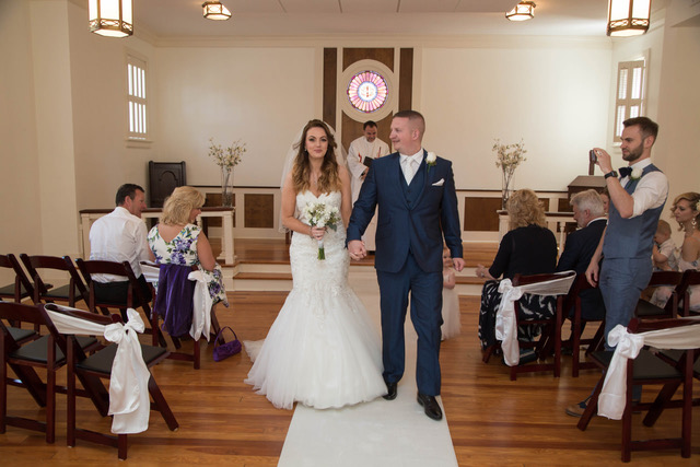 A couple walk down the aisle after getting married at the Winter Park Wedding Chapel with Winter Park Wedding Company