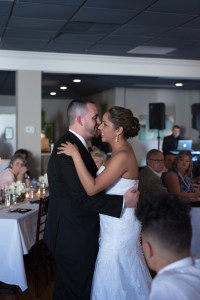A newlywed couple having their first dance at their wedding reception in the private room at Blu on Park Avenue
