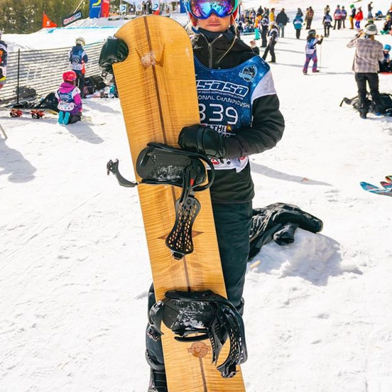 We like to go fast too!  @chloewhipple with her custom race board at the @usasasnow Boardercross event last Thursday. #racetime @coppermtn