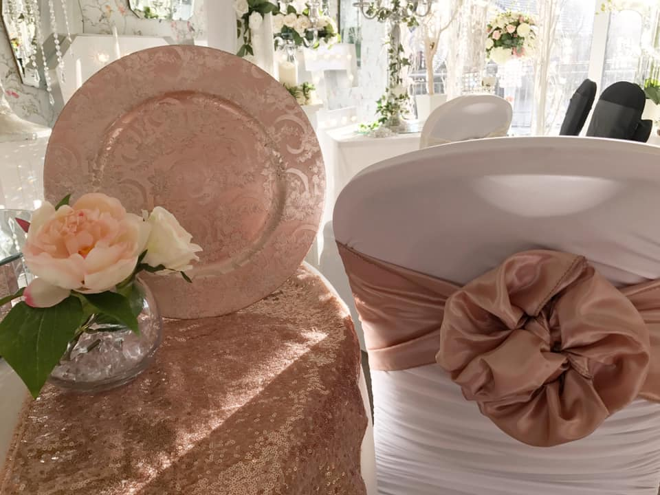 chair covers rose gold steel visitors price charger plate cover and floral arrangement winton