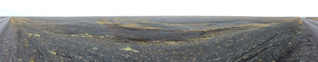 Sandur outwash plain in Iceland. Bare, flat rocky landscape