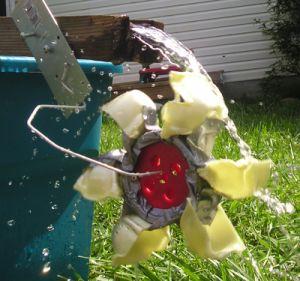 Egg carton pockets, duct tape, Capsela wheels and a coat hanger made a quick backyard wheel.