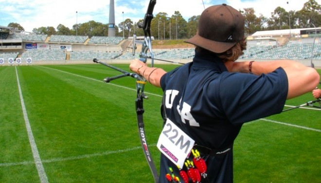 Jake Kaminski practicing archery