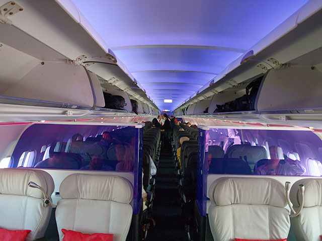 Interior of Virgin America cabin with purple mood lighting