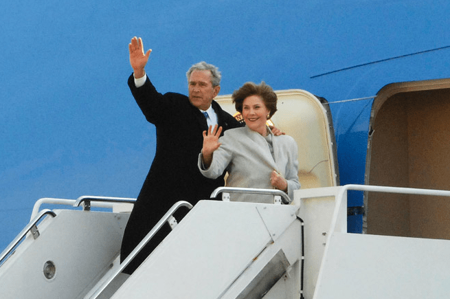 President George W. Bush and wife, Laura, board Air Force One for last time as President Barack Obama succeeded him.