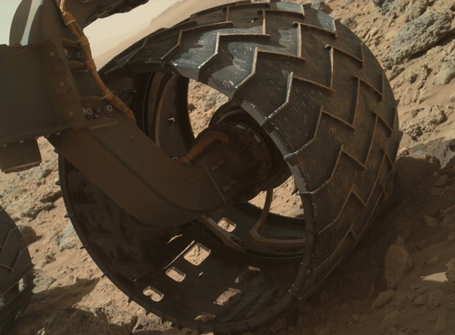 The left-front wheel of NASA's Curiosity Mars rover shows dents and holes. Image: NASA Jet Propulsion Laborator