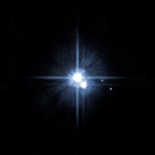 This Hubble image from 2006 shows Pluto and three of its moons, Charon, Nix, and Hydra.