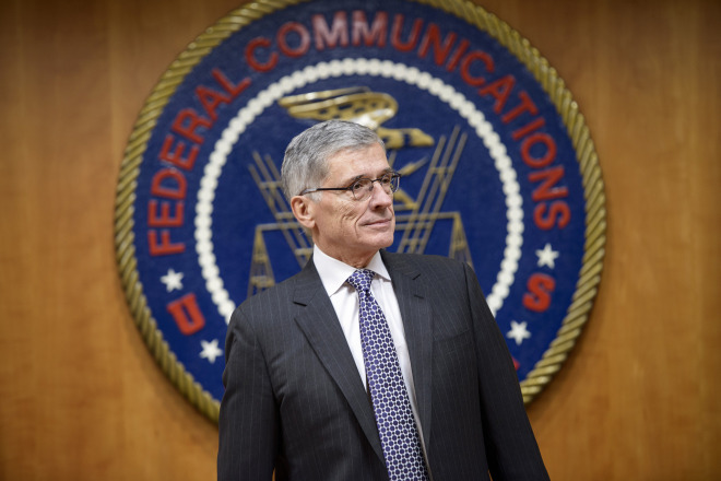Federal Communication Commission(FCC) Chairman Tom Wheeler waits for a hearing at the FCC December 11, 2014 in Washington, DC.