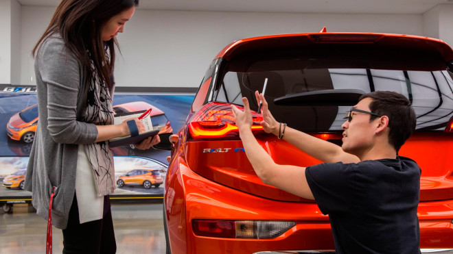 GM designers discuss fine-tuning the window glass on the Bolt's lift gate.  Courtesy of GM