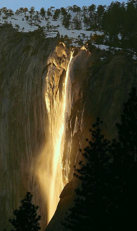sun hitting yosemite waterfall