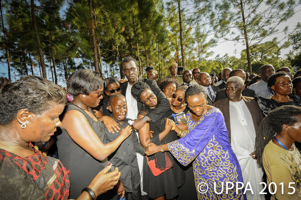 Justice Lydia Mugambe (fourth right) comforts the children of Prosecutor Joan Kagezi, who was murdered in the presence of her children on her way home near Ntinda in Kampala, April.2, 2015