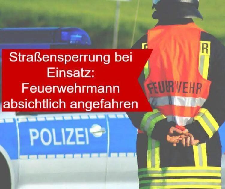 Symbolbild Straßensperrung durch die Feuerwehr