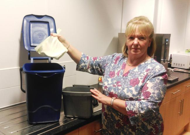 FLASHBACK: Cllr Bernie Mooney tries out the new containers which residents will receive if the proposal to introduce household food recycling to the borough is accepted