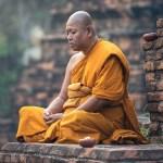 A Buddhist monk meditating