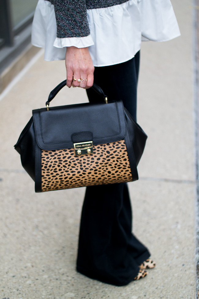 flared black jeans and leopard accents