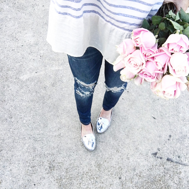 striped top, distressed jeans, silver loafers, silver flats, pink roses, casual spring outfit