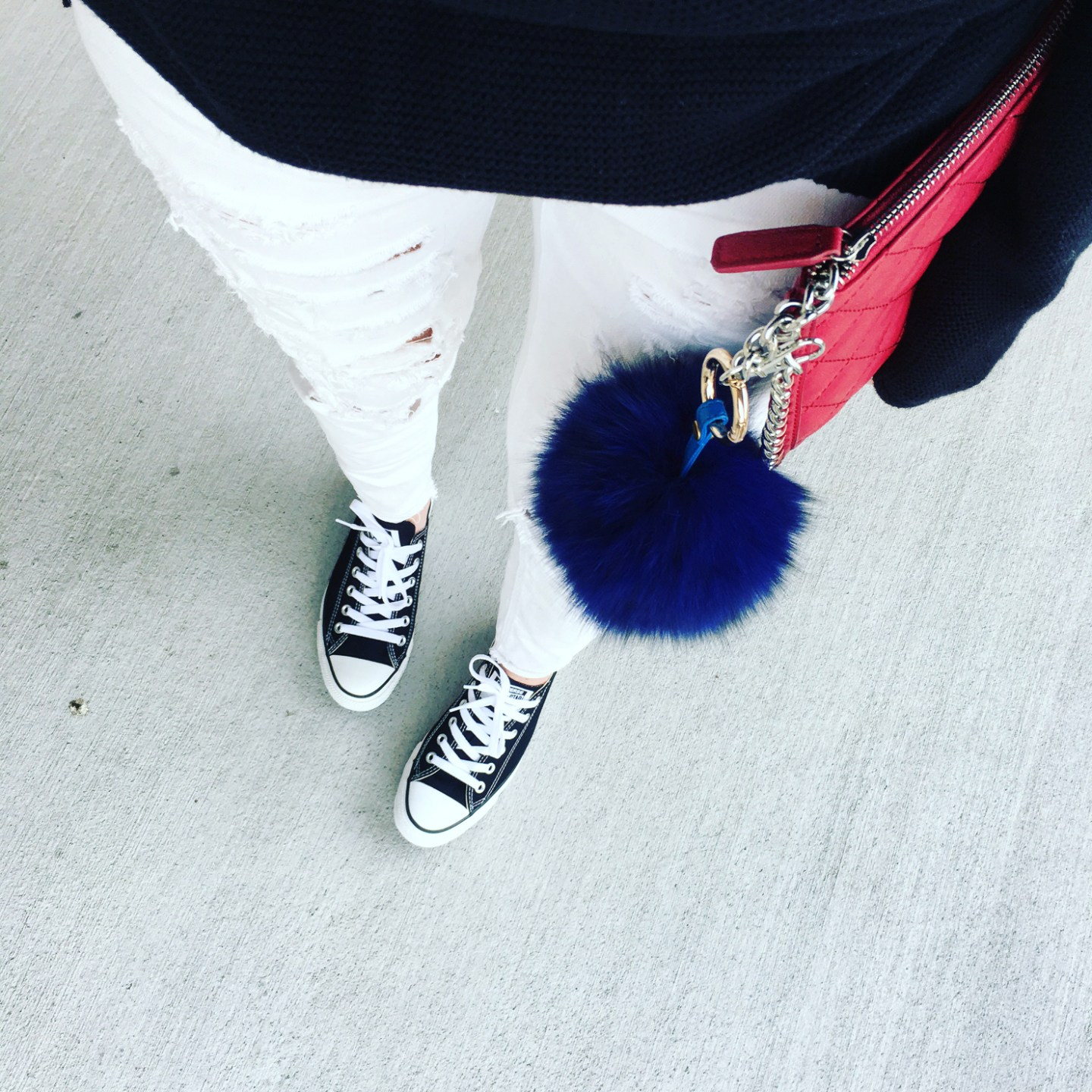 white distressed jeans, black converse, black chucks, blue fur bag pompom, red chanel look for less