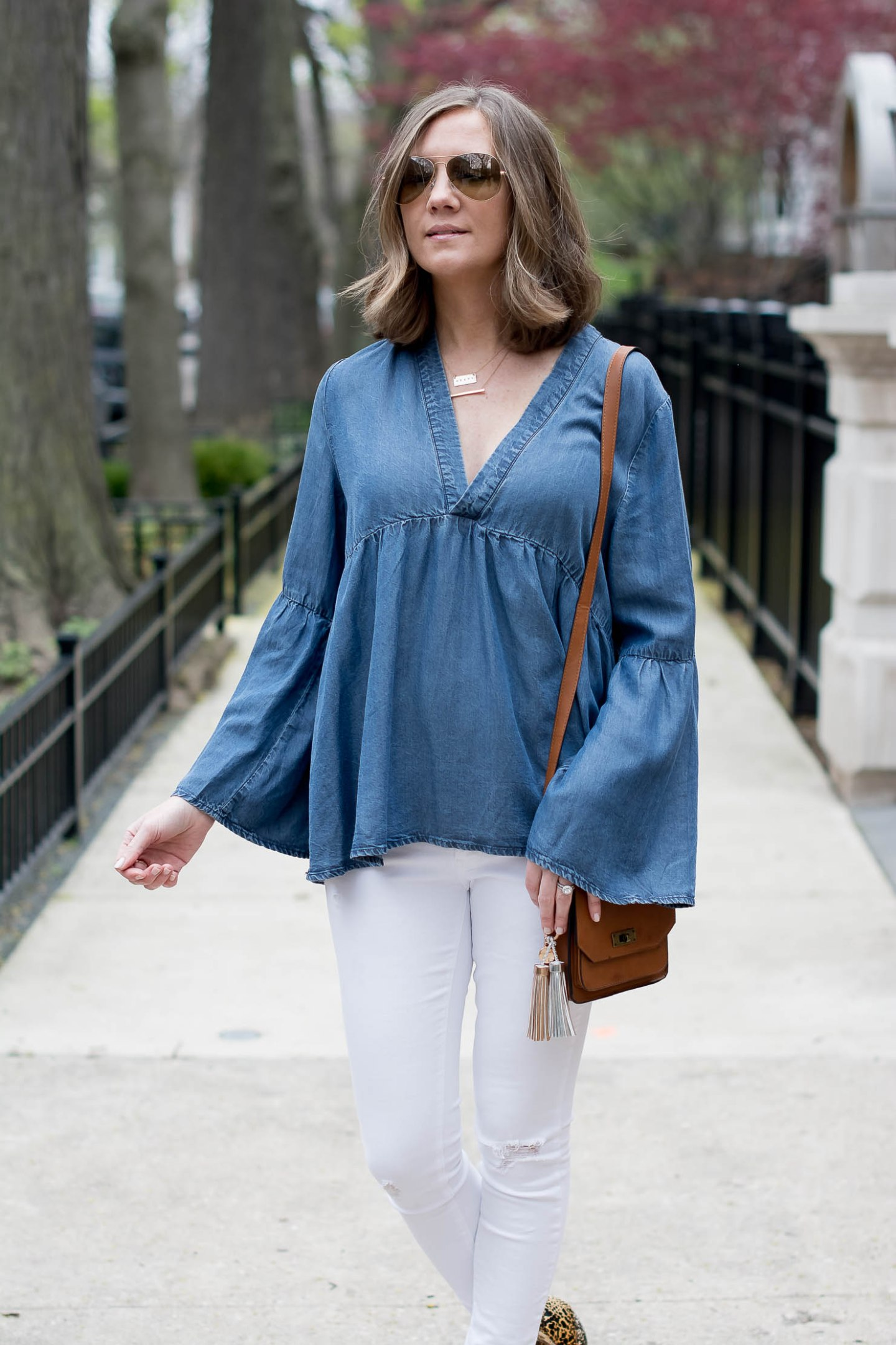 transitioning-white-jeans-for-fall-hm-denim-bell-sleeve-top-matisse-leopard-booties-metallic-bag-tassel-charms-5