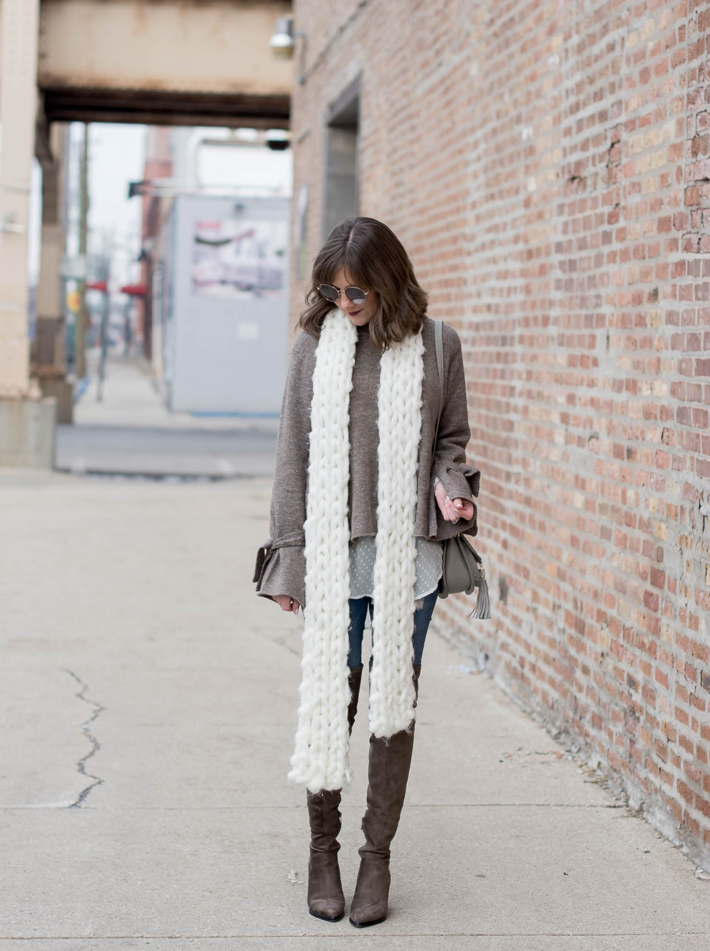 loving-the-tie-cuff-sweater-trend-bell-sleeve-sweater-zara-tie-cuff-sweater-neutral-layers-marc-fisher-alinda-boots-free-people-chunky-scarf