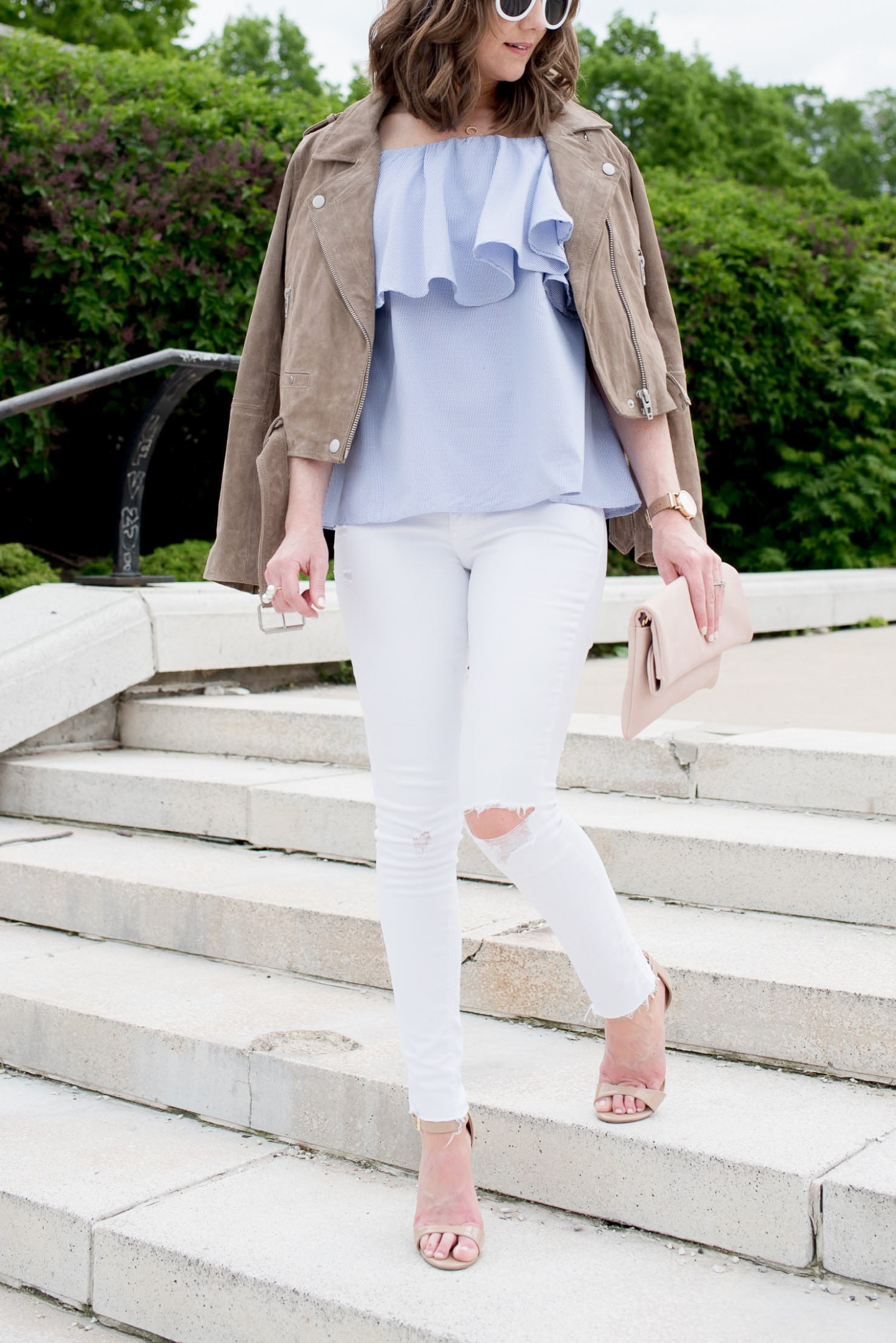 how to wear spring trends when its still cold, layering for spring, off the shoulder ruffle flounce top, blanknyc suede jacket, a white denim outfit