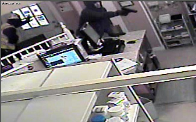 Suspect in Elwood robbery, police action shooting_564461