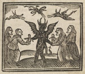 Witches presenting wax dolls to the devil