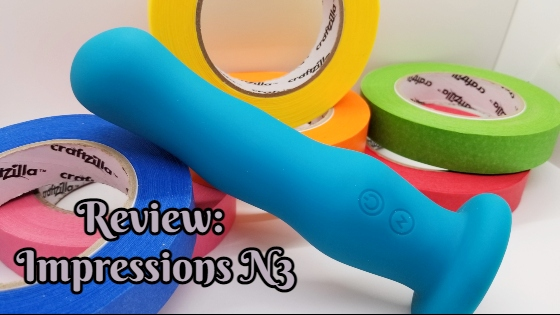 Impressions N3 sitting among colorful rolls of tape