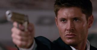 Dean pointing a gun
