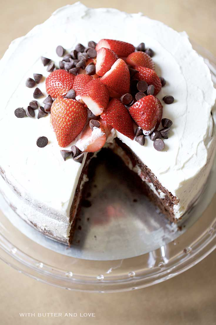 Chocolate Strawberry & Mascarpone Layer Cake || Rich, fudgy layers of chocolate cake filled with whipped mascarpone cheese and topped with fresh whipped cream and strawberries. || www.withbutterandlove.com