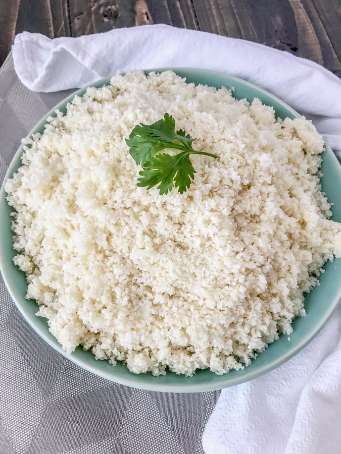 How To Make and Freeze Cauliflower Rice - this is the perfect healthy, low-carb alternative to rice, quinoa, or pasta. Being that it contains only one ingredient, it is perfect for almost any meal plan and is also easier to make than you think! All you need is a knife with a cutting board and a food processor. #cauliflower #cauliflowerrice #howto #diy #doityourself #sidedish #healthy