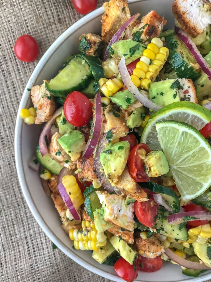 Cajun LimeChicken Avocado Salad - this salad has so much flavor! It is quick and easy to make and perfect for your next barbecue or get together. Refreshing, creamy, and filling - but light! Light on the calories, coming in at only 203 calories per 1 cup serving. The best part? It's just as delicious the next day, making this a good meal for your to-go lunches for either work, school or travel. #lunch #togo #avocado #avocadosalad #salad #chickensalad #healthy | https://withpeanutbutterontop.com