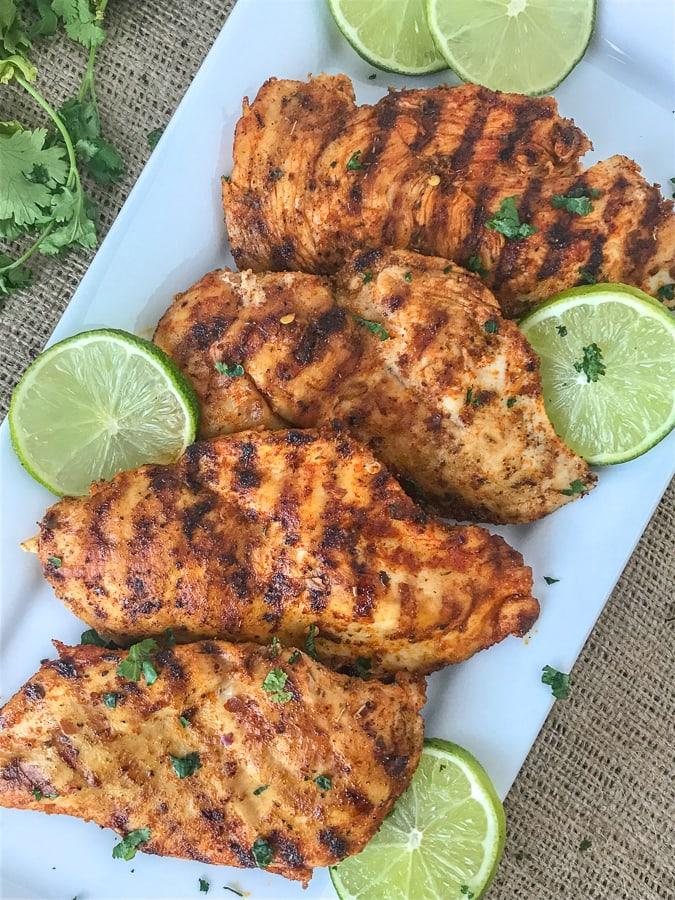 Grilled Cajun Lime Chicken - juicy, tender and flavorful chicken that is super easy to make and can be on your table in under 15 minutes!And can you really go wrong with a delicious slice of chicken that is under 200 calories?? #healthy #cajunseasoning #cajun #chickenbreast #grilledchicken #dinner | https://withpeanutbutterontop.com